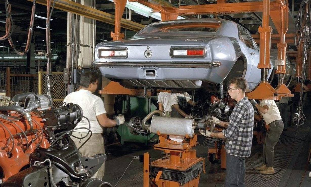 Chassis being raised into the body GM Photo
